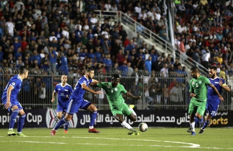 Morocco's Raja Casablanca the first football club from North Africa to play in the Palestinian territories beat Palestinian team Hilal al-Quds (blue) 2-0 in the Arab Champions Cup at the Faisal Husseini stadium in the town Al-Ram near Jerusalem (AFP Photo/ABBAS MOMANI)