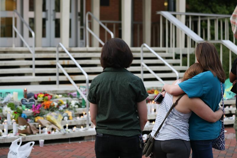 Students pay their respects to victims of the April 30th, 2019 mass shooting at University of North Carolina Charlotte. (Photo: Getty Images)