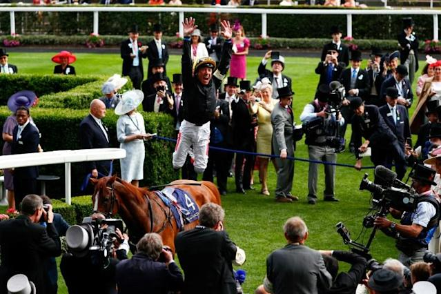 What a scorcher - Frankie Dettori is on course to break his personal record of 16 Group One wins in 2001 after riding Too Darn Hot to victory in the Sussex Stakes at Goodwood (AFP Photo/Adrian DENNIS)