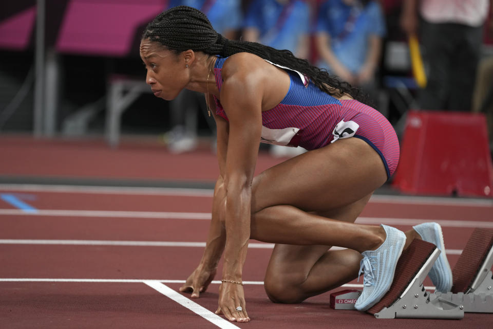 Allyson Felix, of the United States, prepares to start in a semifinal of the women's 400-meters at the 2020 Summer Olympics, Wednesday, Aug. 4, 2021, in Tokyo. (AP Photo/Matthias Schrader)