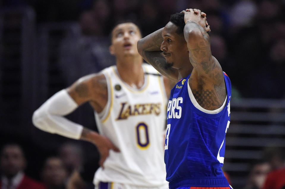 Los Angeles guard Lou Williams, with his hands on his head.