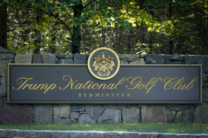 FILE - This photo from Friday Oct. 2, 2020, shows a sign at the entrance to Trump National Golf Club in Bedminster, N.J. The PGA canceled its tournament at President Donald Trump's golf course since the deadly riots at the U.S. Capitol. (AP Photo/Seth Wenig, File)