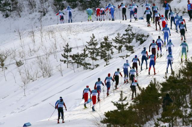 Cross-Country Skiing - Pyeongchang 2018 Winter Olympics - Men's 50km Mass Start Classic - Alpensia Cross-Country Skiing Centre - Pyeongchang, South Korea - February 24, 2018 - Martin Johnsrud Sundby of Norway leads the pack. REUTERS/Carlos Barria