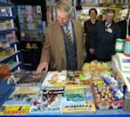 <p>Prince Charles peruses the headlines on a newsstand in Cumbria. </p>