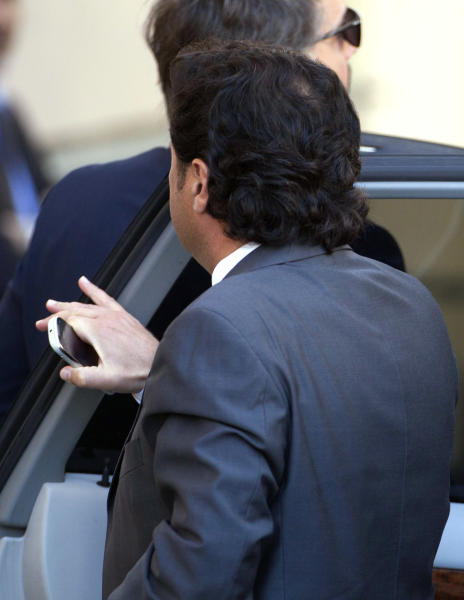 Capt. Francesco Schettino arrives to attend a preliminary, closed-door hearing for the 2012 grounding off Tuscany that killed 32 people, in Grosseto, Italy, Monday, April 15, 2013. An Italian court is mulling whether to hand down indictments against the captain and some crew of the Costa Concordia cruise ship for the 2012 grounding off Tuscany that killed 32 people. Prosecutors want Capt. Francesco Schettino to stand trial for alleged manslaughter, causing a shipwreck and abandoning the ship before all passengers had been evacuated. They want four other crew members and a Costa manager to face charges of having botched the emergency Schettino attended the preliminary, closed-door hearing Monday in the Tuscan city of Grosseto; the timing of a decision was unknown. (AP Photo/Andrew Medichini)