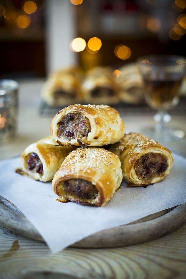 """<p>Make a classic sausage roll with a Christmas twist. Serve it with spicy mustard or one of your favorite sauces.</p><p><strong>Get the recipe at <a href=""""https://donalskehan.com/recipes/cranberry-sausage-rolls/"""" rel=""""nofollow noopener"""" target=""""_blank"""" data-ylk=""""slk:Donal Skehan"""" class=""""link rapid-noclick-resp"""">Donal Skehan</a>.</strong></p><p><strong><a class=""""link rapid-noclick-resp"""" href=""""https://go.redirectingat.com?id=74968X1596630&url=https%3A%2F%2Fwww.walmart.com%2Fsearch%2F%3Fquery%3Dbaking%2Bsheet&sref=https%3A%2F%2Fwww.thepioneerwoman.com%2Ffood-cooking%2Fmeals-menus%2Fg34272733%2Fchristmas-party-appetizers%2F"""" rel=""""nofollow noopener"""" target=""""_blank"""" data-ylk=""""slk:SHOP BAKING SHEETS"""">SHOP BAKING SHEETS</a><br></strong></p>"""