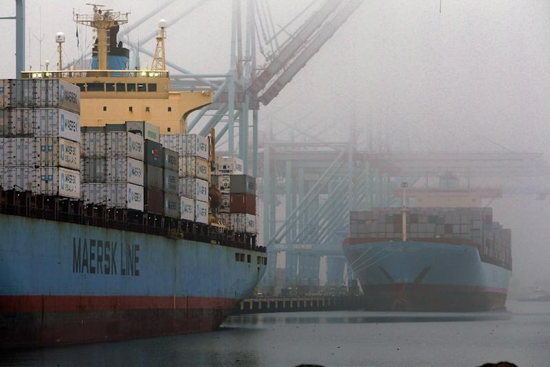 In this Wed. Dec. 5, 2012, photo, containers are unloaded from cargo ships at  the Port of Los Angeles. Most economists agree that the snapshot of U.S. economic growth released Wednesday, Jan. 30, 2012, is going to look dismal. (AP Photo/Nick Ut)