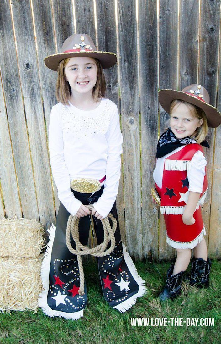 """<p>Dress your kids in these sweet rodeo outfits. This sewing tutorial is simple enough, and they'll love all the glitter and rhinestone accents!</p><p><strong>Get the tutorial at <a href=""""https://love-the-day.com/rodeo-queen-costume"""" rel=""""nofollow noopener"""" target=""""_blank"""" data-ylk=""""slk:Love the Day"""" class=""""link rapid-noclick-resp"""">Love the Day</a>.</strong></p><p><a class=""""link rapid-noclick-resp"""" href=""""https://go.redirectingat.com?id=74968X1596630&url=https%3A%2F%2Fwww.walmart.com%2Fip%2FNext-Style-Single-Bandana-Paisley-Black%2F21668202&sref=https%3A%2F%2Fwww.thepioneerwoman.com%2Fholidays-celebrations%2Fg33925966%2Fwestern-halloween-costumes%2F"""" rel=""""nofollow noopener"""" target=""""_blank"""" data-ylk=""""slk:SHOP BLACK BANDANAS"""">SHOP BLACK BANDANAS</a></p>"""