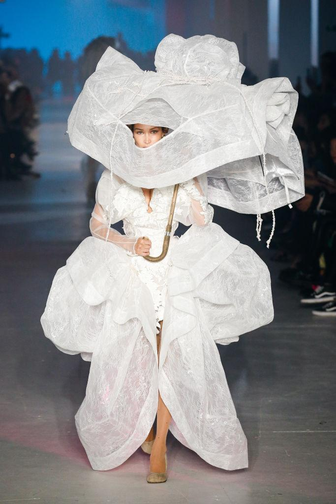 Bella Hadid also took to the runway in an 18th century inspired wedding down [Photo: Getty]