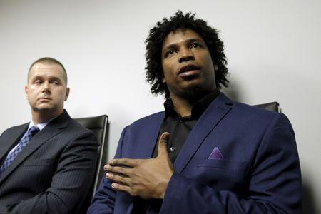 Former Major League Baseball pitcher Jenrry Mejia (R) speaks during a news conference to address his three failed doping tests and lifetime ban, in the Queens borough of New York March 11, 2016. REUTERS/Brendan McDermid