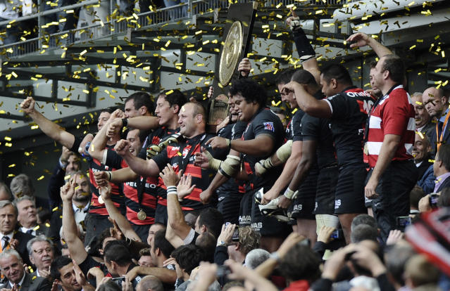 "Toulouse's players hold the ""Bouclier de Brennus"" (Brennus shield) as they celebrate after winning the French Top 14 rugby union final match Toulouse vs Toulon, on June 9, 2011 at the Stade de France in Saint-Denis, outside Paris. AFP PHOTO / FRED DUFOURFRED DUFOUR/AFP/GettyImages"