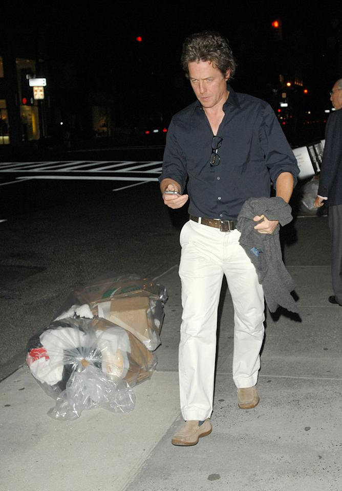 "A surly Hugh Grant attempts to dodge the cameras on his way to dinner in New York City. Ronald Asadorian/Eddie Mejia/<a href=""http://www.splashnewsonline.com/"" target=""new"">Splash News</a> - September 13, 2007"