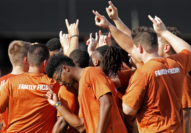 Members of the Texas Longhorns football team huddle during Family Friday practice held Friday Sept. 6, 2019 at Darrell K Royal-Texas Memorial Stadium in Austin, Tx. ( Photo by Edward A. Ornelas )