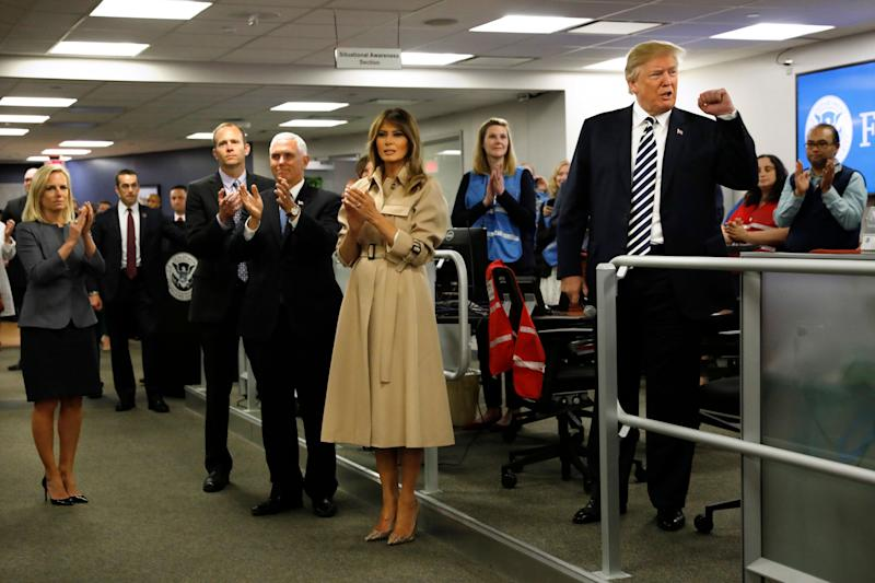 U.S. President Donald Trump, along with first lady Melania Trump and U.S. Vice President Mike Pence, greets employees at the National Response Coordination Center at the Federal Emergency Management Agency Headquarters.