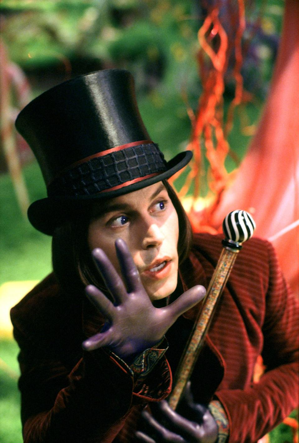 <p>Oh, and we can't forget the plum-colored gloves that fit so tightly, they're like a second skin. Meanwhile, his top hat is black instead of brown and has two stripes that match his coat.</p>