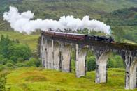 """<p>Starting near Britain's highest mountain, Ben Navis, and ending in the busy fishing port of Mallaig, the <a href=""""https://westcoastrailways.co.uk/jacobite/steam-train-trip"""" rel=""""nofollow noopener"""" target=""""_blank"""" data-ylk=""""slk:Jacobite Steam Train"""" class=""""link rapid-noclick-resp"""">Jacobite Steam Train</a> in Scotland is a must-see. Along the 84-mile journey, you'll make stops in quintessential villages like Glenfinnan, Lochailort, Arisaig, and Morar. <em>Harry Potter </em>fans, take note: The Jacobite was an inspiration for the Hogwarts Express. </p>"""