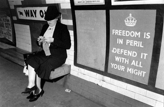 An unidentified woman knits on a bench in the underground train system, London, England, 1939. (Photo: Carl Mydans/The Life Picture Collection/Getty Images)