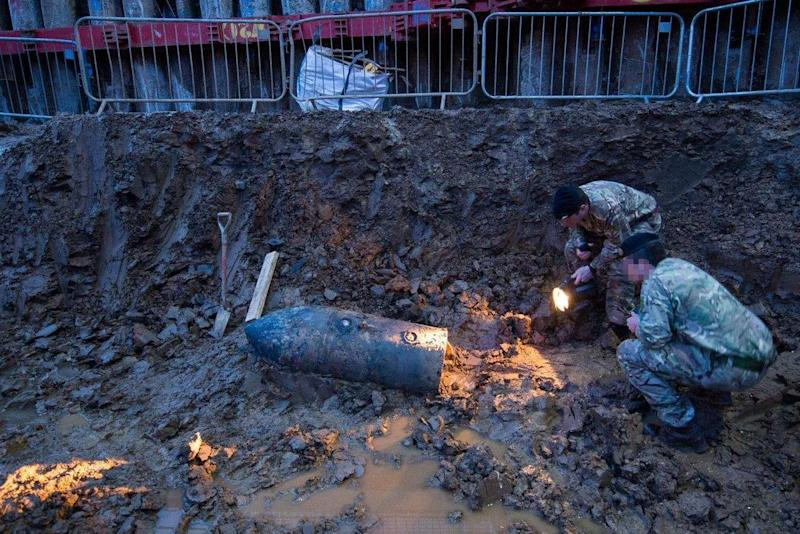 Soldiers inspect the bomb (Rupert Frere/MoD/Crown Copyright/PA)