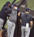 New York Yankees Manager Aaron Boone, center, watches batting practice before a baseball game against the Tampa Bay Rays Tuesday, May 11, 2021, in St. Petersburg, Fla. New York announced two hours before first pitch that third base coach Phil Nevin, who is fully vaccinated, is under quarantine away from the team after a positive COVID-19 test. (AP Photo/Steve Nesius)