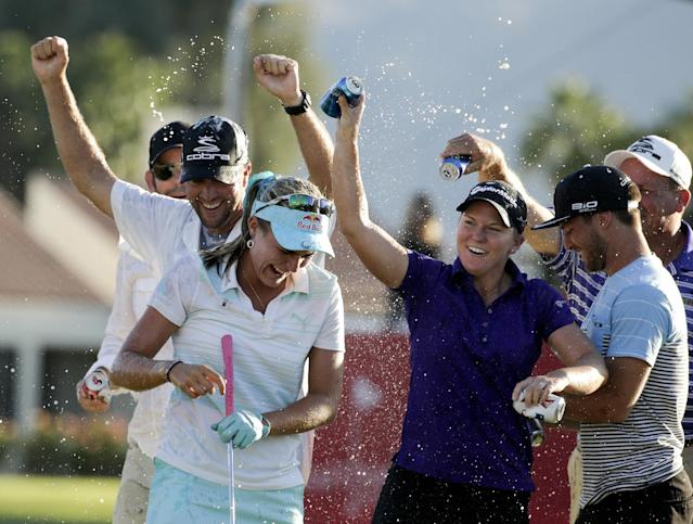FILE - In this April 6, 2014, file photo, Lexi Thompson smiles as she is showered after winning the Kraft Nabisco Championship golf tournament in Rancho Mirage, Calif. Thompson got a congratulatory text from Nancy Lopez and a letter from Arnold Palmer. There was a trip to Germany and a commercial shoot with Usain Bolt. A lot has happened since the 19-year-old American became a major champion three weeks ago. Now it's time to get back on the course. (AP Photo/Chris Carlson, File)