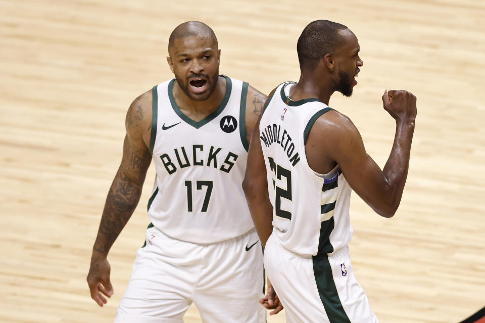 MIAMI, FLORIDA - MAY 27: P.J. Tucker #17 and Khris Middleton #22 of the Milwaukee Bucks celebrate against the Miami Heat during the third quarter in Game Three of the Eastern Conference first-round playoff series at American Airlines Arena on May 27, 2021 in Miami, Florida. NOTE TO USER: User expressly acknowledges and agrees that, by downloading and or using this photograph, User is consenting to the terms and conditions of the Getty Images License Agreement. (Photo by Michael Reaves/Getty Images)