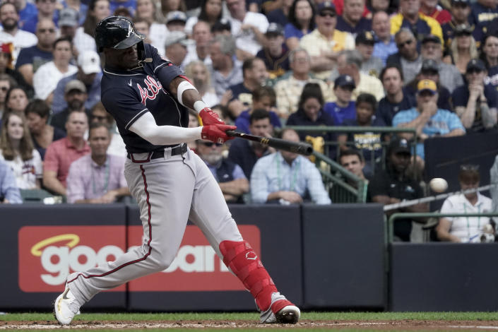 Atlanta Braves' Jorge Soler doubles against the Milwaukee Brewers during the third inning in Game 2 of baseball's National League Divisional Series Saturday, Oct. 9, 2021, in Milwaukee. (AP Photo/Morry Gash)