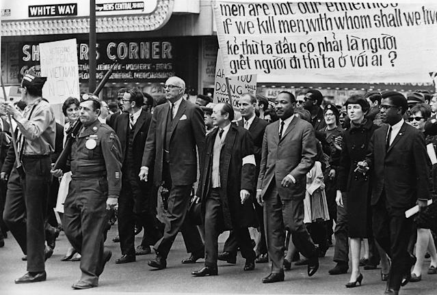 <p>Leading the march against the Vietnam conflict are Dr. Benjamin Spock, tall, white-haired man, and Dr. Martin Luther King Jr., third from right, in a parade on State St. in Chicago, Ill., March 25, 1967. Dr. Spock is co-chairman of the National Committee for Sane Nuclear Policy. (AP Photo) </p>