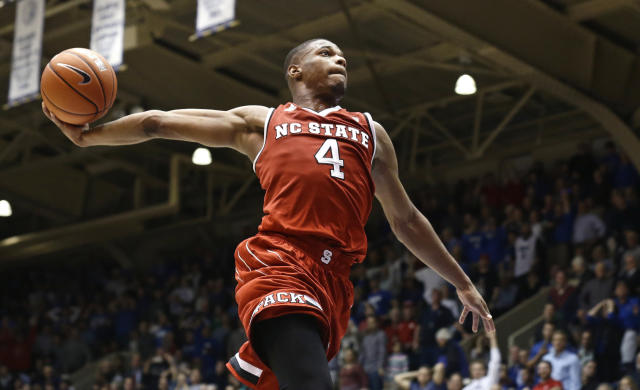 """FILE - In this Jan. 23, 2017, file photo, North Carolina State's Dennis Smith Jr. (4) drives to the basket as time expires in the second half of an NCAA college basketball game against Duke, in Durham, N.C. Bank records and other expense reports that are part of a federal probe into college basketball list a wide range of impermissible payments from agents to at least two dozen players or their relatives, according to documents obtained by Yahoo Sports. A balance sheet from December 2015 lists several payments under """"Loan to Players,"""" including $43,500 to Dallas Mavericks guard Dennis Smith, who played one season at North Carolina State in 2016-17. (AP Photo/Gerry Broome, File)"""