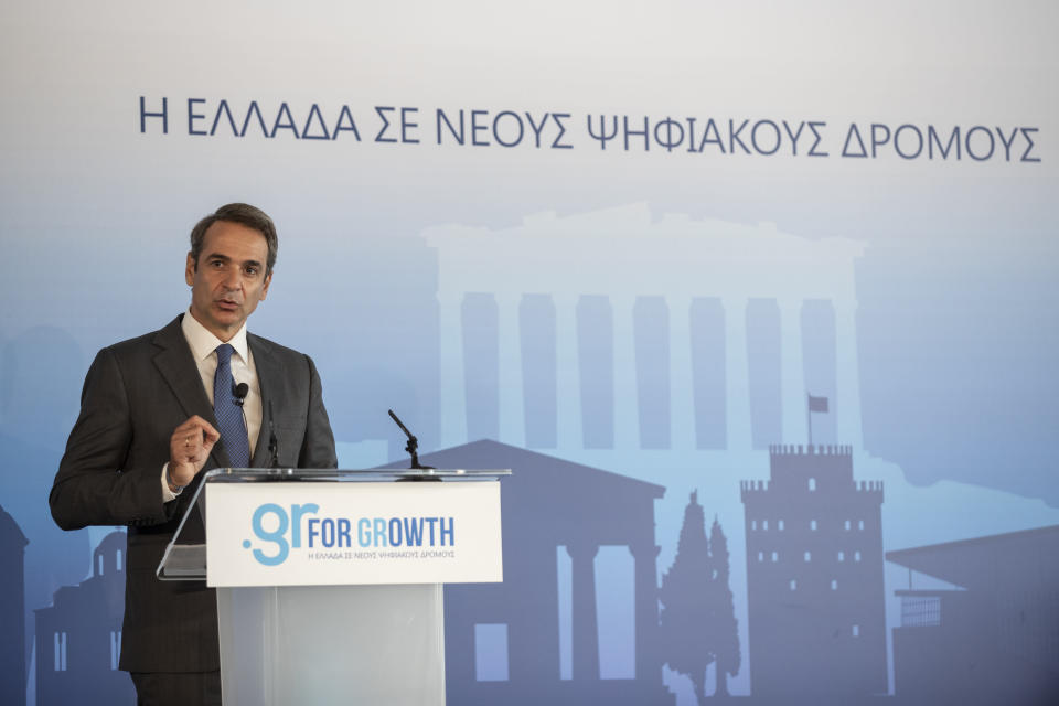 Greek Prime Minister Kyriakos Mitsotakis speaks during a ceremony of Microsoft held in the Acropolis Museum, central Athens, on Monday, Oct. 5, 2020. Microsoft has announced plans to build three data centers in greater Athens, providing a badly needed investment of up to $1 billion to the Greek economy which has been hammered by the pandemic. (AP Photo/Petros Giannakouris)