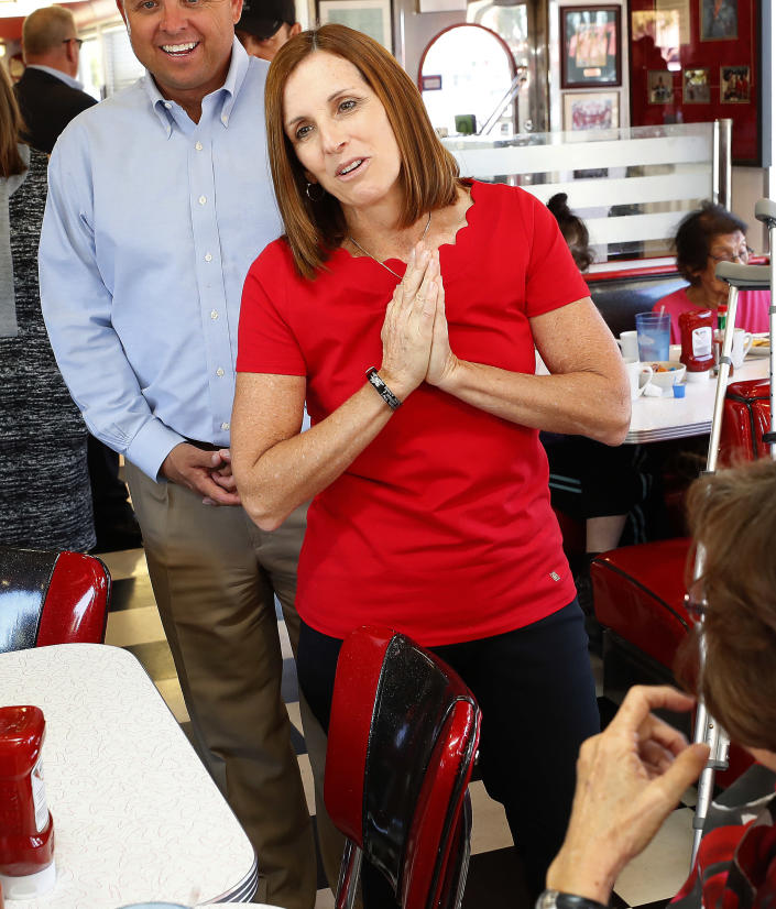Arizona Republican senatorial candidate Martha McSally speaks with voters, Tuesday, Nov. 6, 2018, at Chase's diner in Chandler, Ariz. McSally and Democratic challenger Kirsten Sinema are seeking the senate seat being vacated by Jeff Flake, R-Ariz., who is retiring in January. (AP Photo/Matt York)