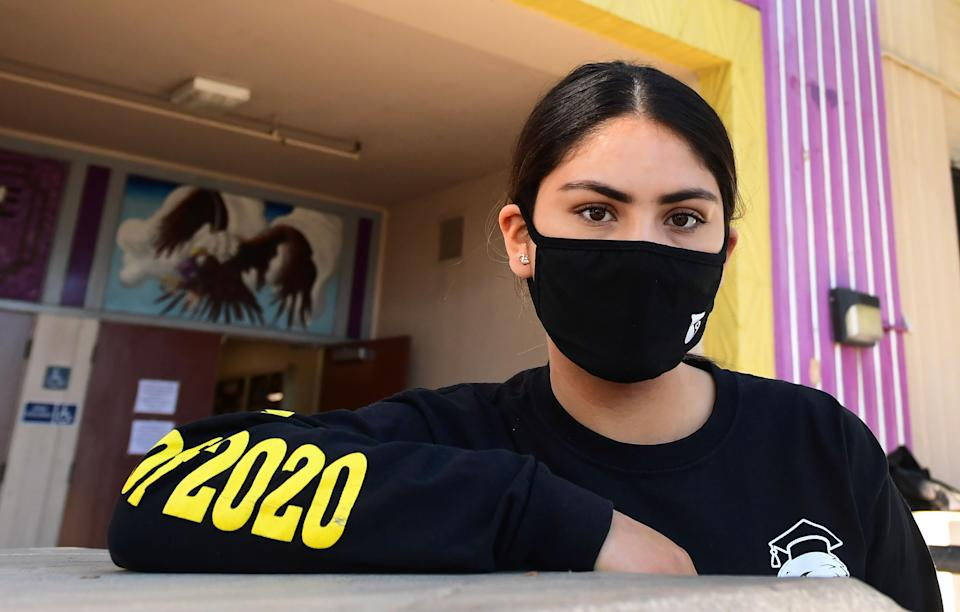 Bell High School senior Kenia Molina in front of campus in Bell, California on April 15, 2020. (Photo: FREDERIC J. BROWN/AFP via Getty Images)