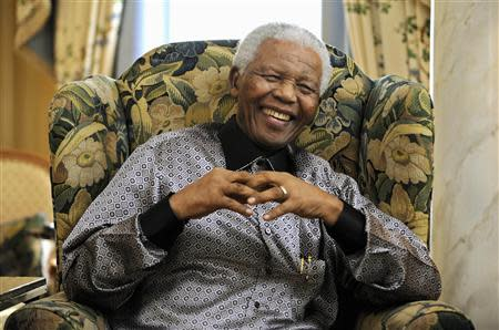 Former president of South Africa Mandela chats with Britain's Prime Minister Brown in London