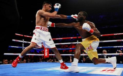 Terence Crawford and Amir Khan in action - Credit: ANDREW COULDRIDGE/Reuters