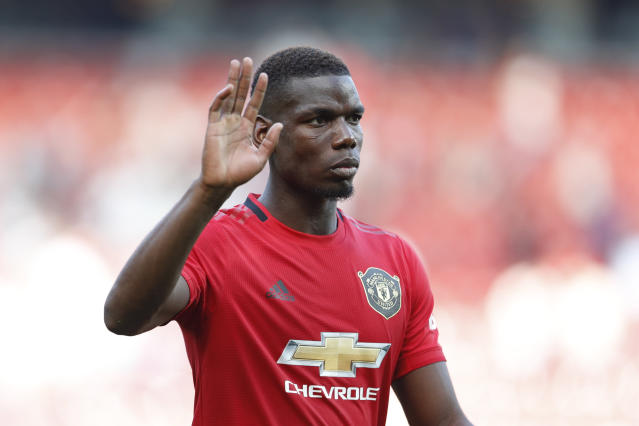 Manchester United's Paul Pogba responded on Sunday after he received multiple racist messages on social media after missing a penalty kick last week. (AP/Alastair Grant)