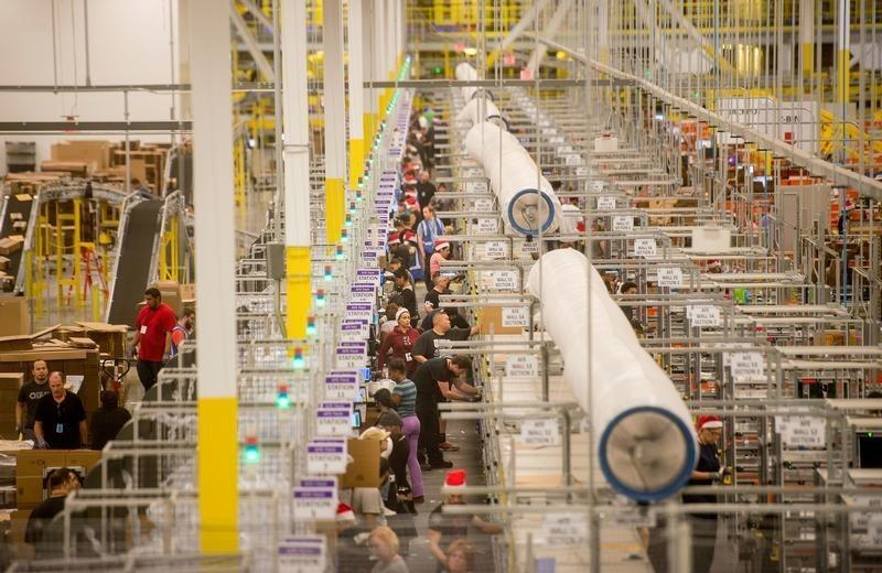 Workers prepare outgoing shipments at an Amazon Fulfillment Center, ahead of the Christmas rush, in Tracy, California
