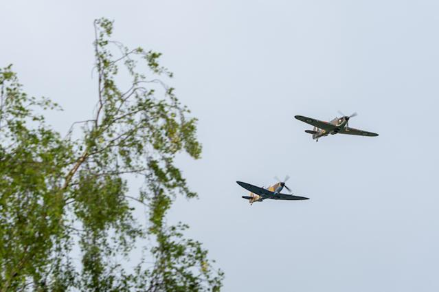 A Battle of Britain Memorial Flight flypast of a Spitfire and a Hurricane to mark Capt Moore's 100th birthday. (PA)