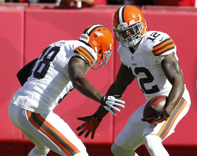 Cleveland Browns wide receiver Josh Gordon (12) celebrates his touchdown with teammate Greg Little (18) during the first half of an NFL football game against the Kansas City Chiefs in Kansas City, Mo., Sunday, Oct. 27, 2013. (AP Photo/Colin E. Braley)
