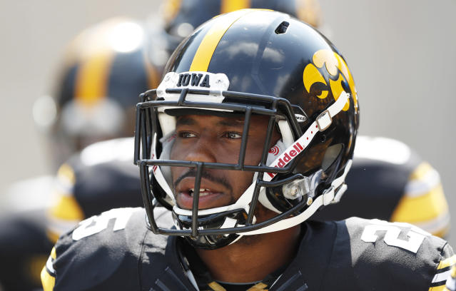 """Iowa running back <a class=""""link rapid-noclick-resp"""" href=""""/ncaaf/players/227377/"""" data-ylk=""""slk:Akrum Wadley"""">Akrum Wadley</a> walks onto the field before an NCAA college football game against North Texas, Saturday, Sept. 16, 2017, in Iowa City, Iowa. (AP Photo/Charlie Neibergall)"""