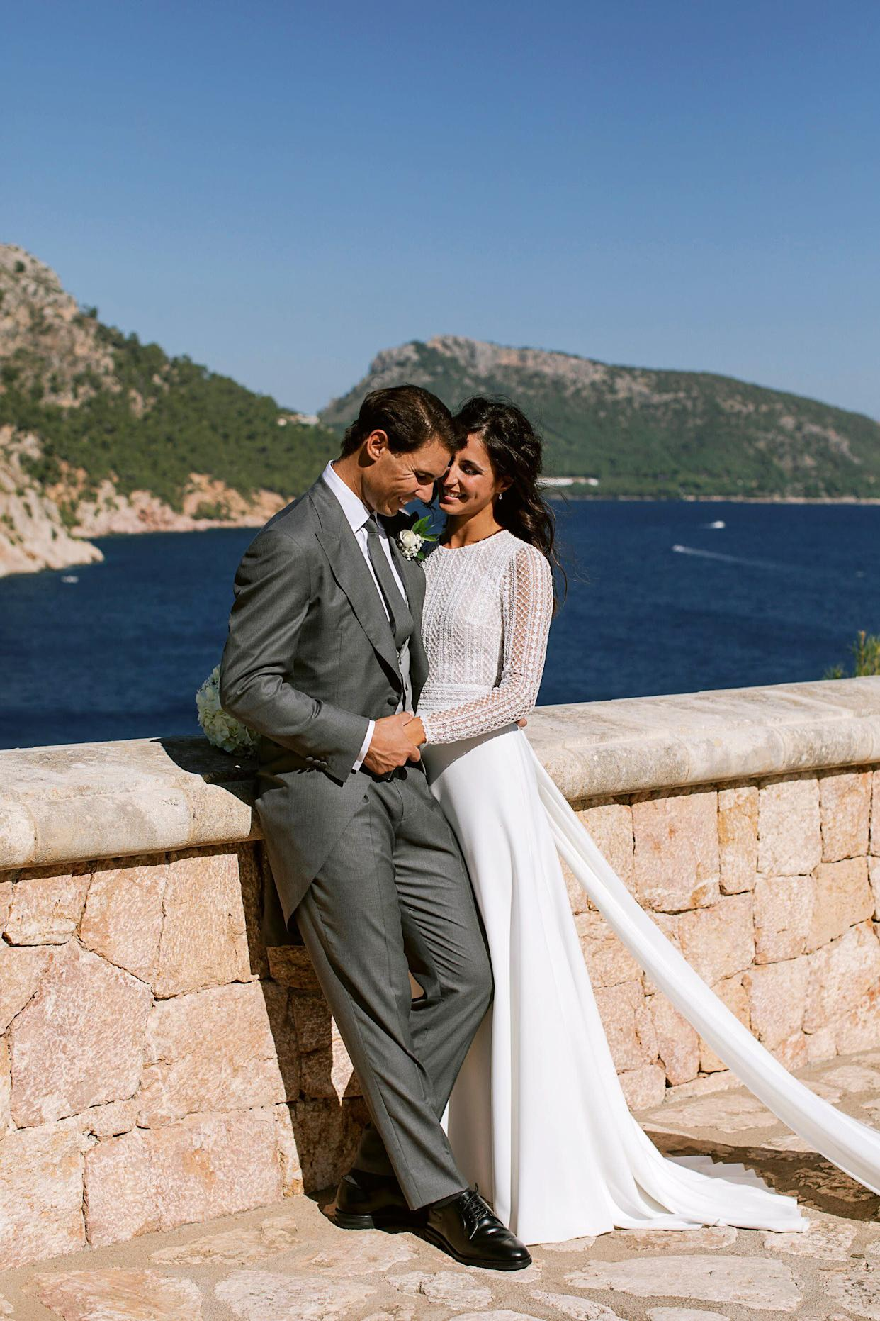 In this handout photo provided by the Fundacion Rafa Nadal, Nadal poses with wife Xisca Perello for the official wedding portraits after they were married on Oct. 19 in Mallorca, Spain. (Photo: Handout via Getty Images)