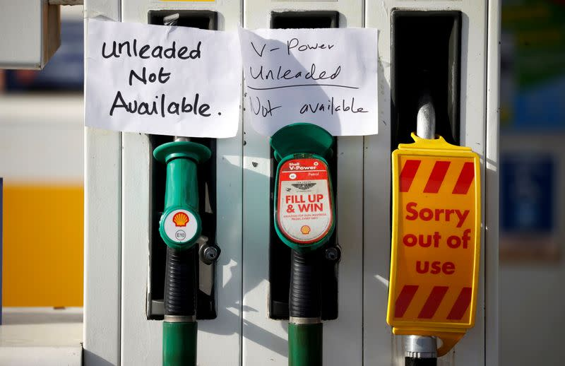 FILE PHOTO: Hand written signs are stuck to a petrol pump with no fuel available at a Shell filling station in Manchester