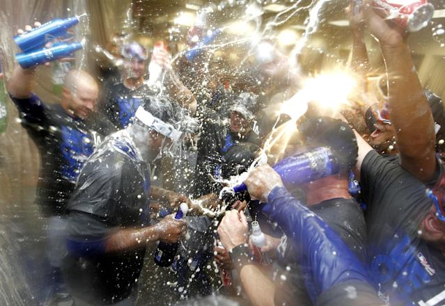 The Los Angeles Dodgers celebrate clinching the NL West title with a 7-6 win over Arizona Diamondbacks in a baseball game, Thursday, Sept. 19, 2013, in Phoenix. (AP Photo/Matt York)