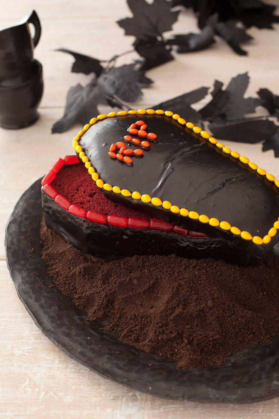 """<p>Dessert becomes a graveyard smash when it's a red velvet cake that's been baked in a loaf pan and cut into a coffin shape. Chop off the top to turn it into a lid that, when perched slightly askew, looks like a vampire escaped.</p><p><em><a href=""""https://www.womansday.com/food-recipes/food-drinks/recipes/a11307/coffin-cake-recipe-122711/"""" rel=""""nofollow noopener"""" target=""""_blank"""" data-ylk=""""slk:Get the recipe for Coffin Cake"""" class=""""link rapid-noclick-resp"""">Get the recipe for Coffin Cake</a>.</em></p>"""