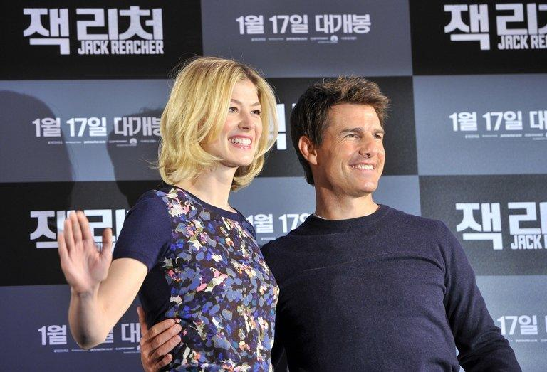"Tom Cruise and Rosamund Pike at a press conference for their movie ""Jack Reacher"" in Seoul on January 10, 2013"