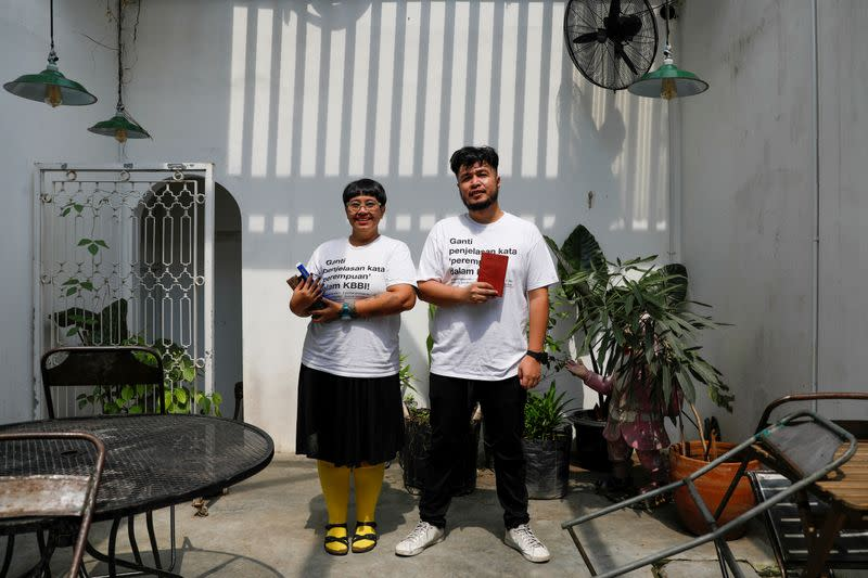 Ika Vantianti and her colleague Yolando Zelkeos Siahaya, pose for pictures at a cafe in Jakarta
