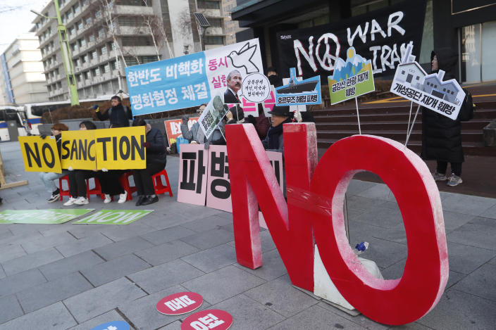 """Anti-war activists stage a rally against the South Korean government's decision to send troops to Hormuz Strait, near the U.S. Embassy in Seoul, South Korea, Tuesday, Jan. 21, 2020. South Korean government on Tuesday said in a press release that the government had decided to send troops to Hormuz Strait to protect South Korean citizens and guarantee the freedom of navigation in the region. The sign reads """"We oppose dispatch of Hormuz Strait."""" (AP Photo/Ahn Young-joon)"""