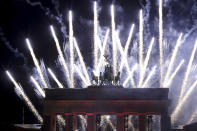 Fireworks light the sky during the New Year's celebrations at the Brandenburg Gate in Berlin, early Friday, Jan. 1, 2021. Germany is entering 2021 in a lockdown that appears certain to be extended beyond its current Jan. 10 end date, with new coronavirus cases and deaths related to COVID-19 remaining at worryingly high levels. (AP Photo/Michael Sohn)