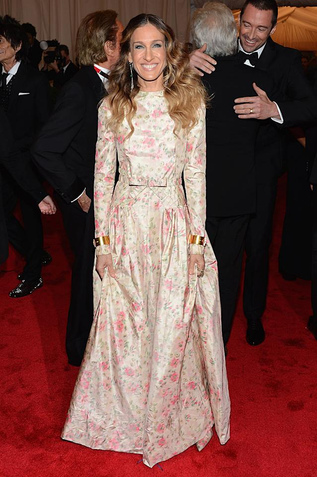 "<p class=""MsoNormal""><span style=""font-size:10.0pt;"">Wowee wallpaper! The usually stylish Sarah Jessica Parker went with a bizarre ""Little House on the Prairie""-like Valentino gown, which looked even more odd with the Wonder Woman-esque pair of gold cuffs she wore over the sleeves.</span></p>"