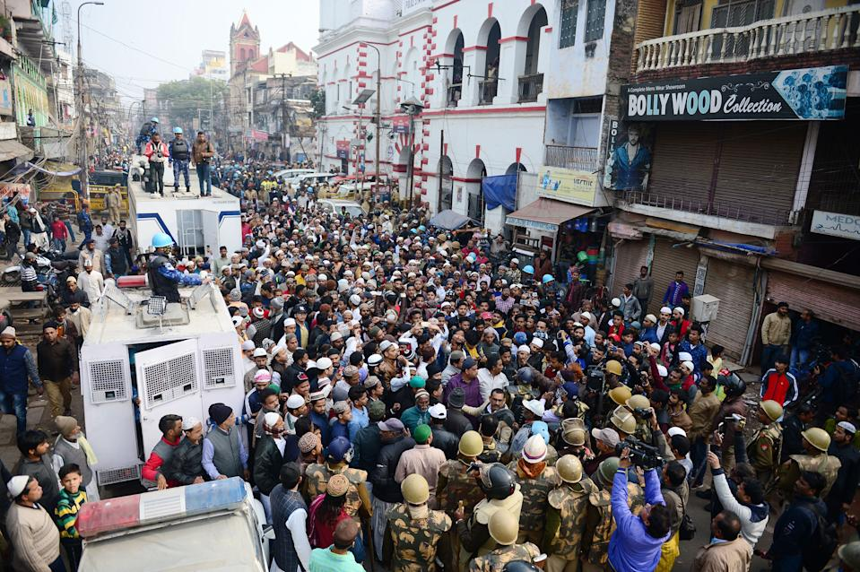 Protesters gather outside the Jama Masjid mosque during demonstrations against India's new citizenship law in Allahabad on December 20, 2019. - Fresh clashes between Indian police and demonstrators erupted on December 20 after more than a week of deadly unrest triggered by a citizenship law seen as anti-Muslim. (Photo by SANJAY KANOJIA / AFP) (Photo by SANJAY KANOJIA/AFP via Getty Images)