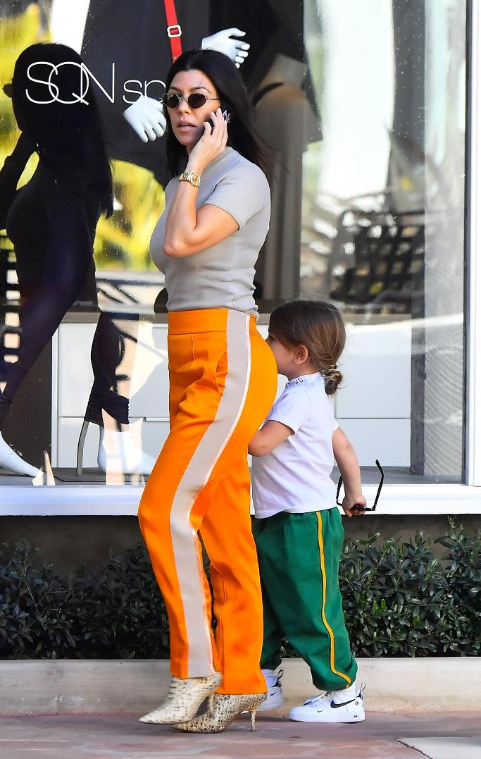 809533cf04d Kourtney Kardashian Commands Attention in Bright Orange Pants ...
