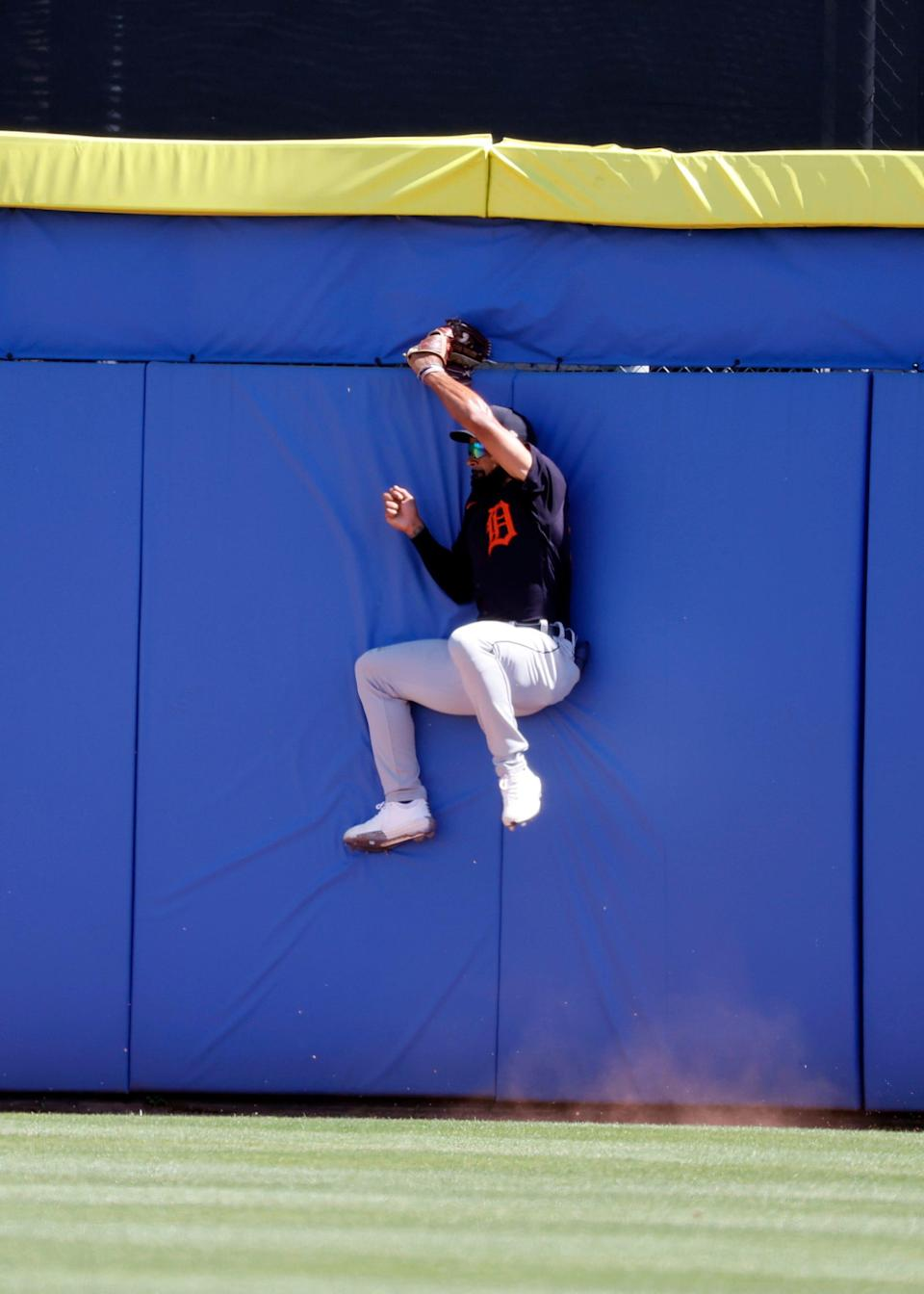 Detroit Tigers center fielder Derek Hill (54) catches a fly ball during the third inning of a spring training game against the Toronto Blue Jays on March 11, 2021, at TD Ballpark in Dunedin, Florida.